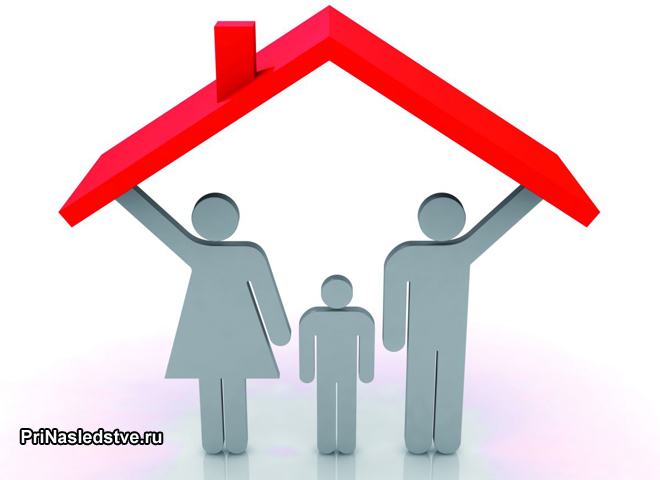 Фигурки семьи из трех человек под крышей домика