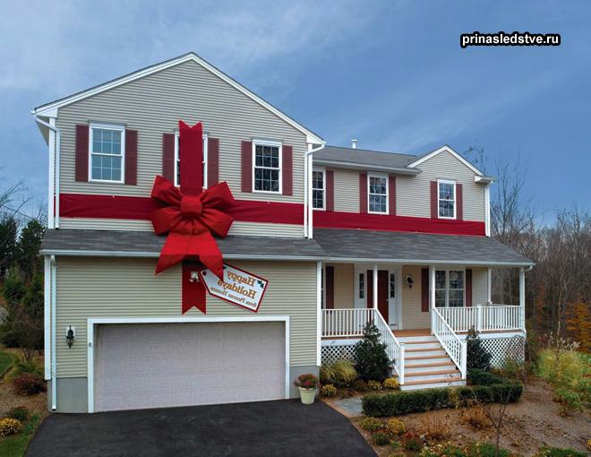 Двухэтажный дом с красным подарочным бантом